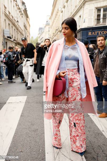 A guest wearing Thom Brown outside Thom Browne during Paris Fashion Week Womenswear Spring Summer 2020 on September 29 2019 in Paris France