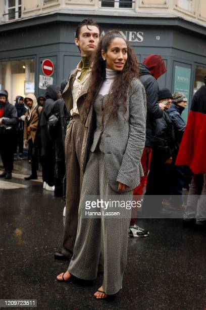 Guest wearing Thom Browne plaid suit outside Thom Browne during Paris Fashion Week Womenswear Fall/Winter 2020/2021 Day Seven on March 01, 2020 in...