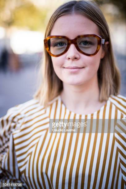 A guest wearing tortoiseshell sunglasses is seen after the Marques Almeida show on September 26 2018 in Paris France
