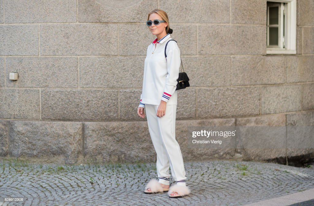 A Guest Wearing Track Suit Chanel Bag Outside Holzweiler On August