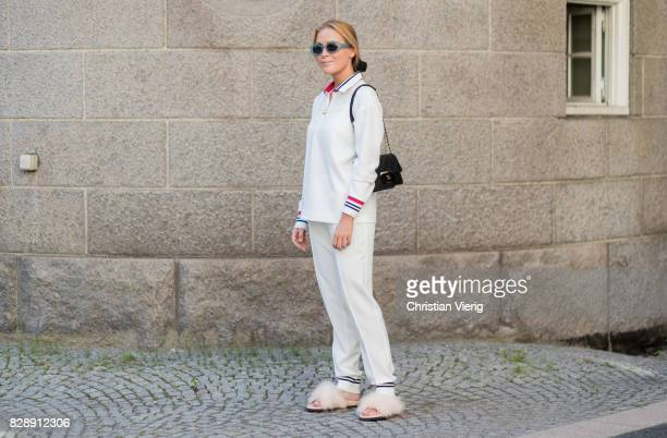 A guest wearing track suit Chanel bag outside Holzweiler on August 09 2017 in Copenhagen Denmark