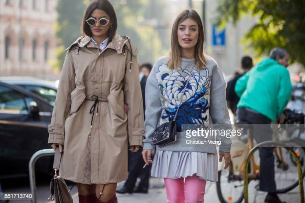 A guest wearing trench coat and Aida Domenech is seen outside Tods during Milan Fashion Week Spring/Summer 2018 on September 22 2017 in Milan Italy