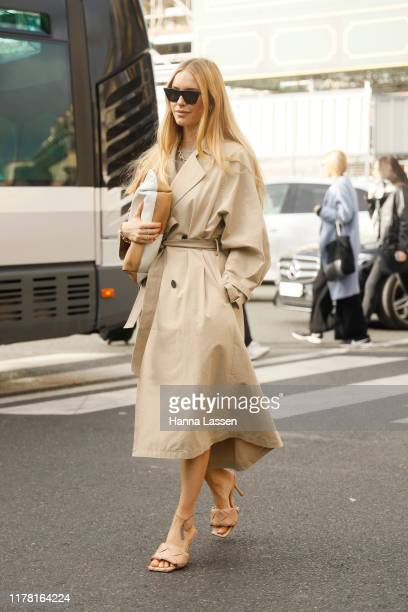 Guest wearing trench coat and Bottega BVeneta mules outside Stella McCartney during Paris Fashion Week Womenswear Spring Summer 2020 on September 30,...