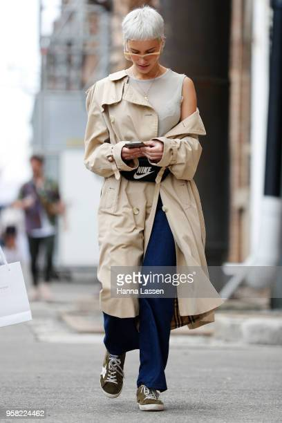 A guest wearing trench coat and nacy pants during MercedesBenz Fashion Week Resort 19 Collections at Carriageworks on May 14 2018 in Sydney Australia
