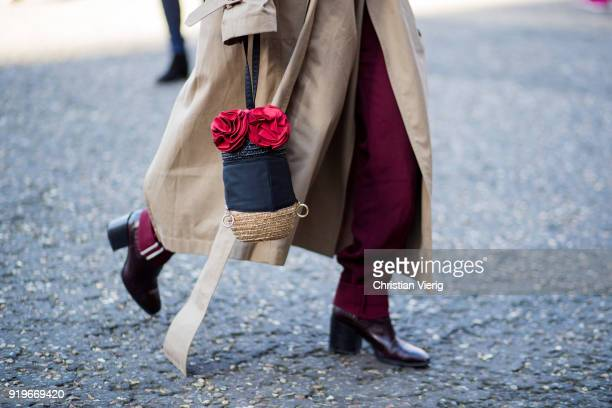 A guest wearing trench coat bag seen outside Ports 1961 during London Fashion Week February 2018 on February 17 2018 in London England