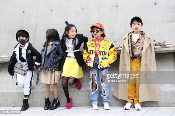 Guest wearing trench coat Burberry shirt is seen at the Hera Seoul Fashion Week 2019 F/W at Dongdaemun Design Plaza at Dongdaemun Design Plaza on...