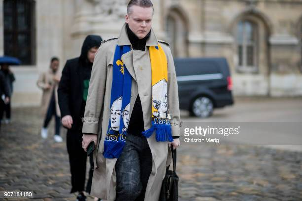 A guest wearing trench coat football scarf is seen outside Maison Margiela on January 19 2018 in Paris France
