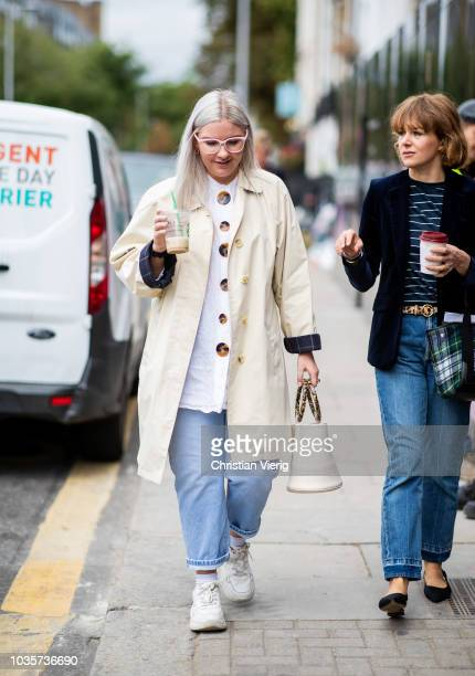 A guest wearing trench coat is seen outside Natasha Zinko during London Fashion Week September 2018 on September 18 2018 in London England