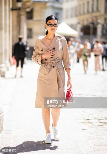 A guest wearing trench coat is seen outside Thom Browne on day five of Paris Fashion Week Menswear SS19 on June 23 2018 in Paris France