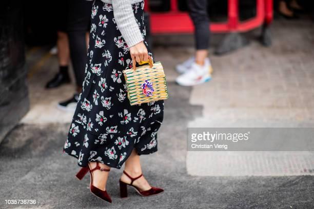 A guest wearing turtleneck knt skirt with floral print basket bag is seen outside Natasha Zinko during London Fashion Week September 2018 on...