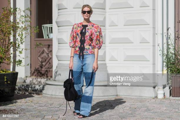 A guest wearing two tone denim jeans blouse outside Stylein on August 30 2017 in Stockholm Sweden
