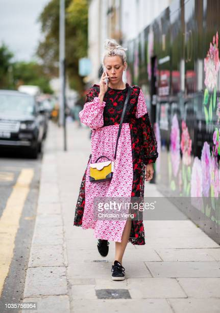 A guest wearing two tone multi colored and printed dress is seen outside Natasha Zinko during London Fashion Week September 2018 on September 18 2018...