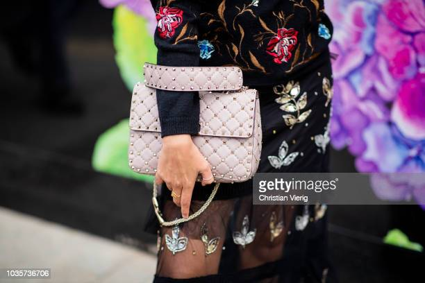 A guest wearing Valentino bag is seen outside Natasha Zinko during London Fashion Week September 2018 on September 18 2018 in London England
