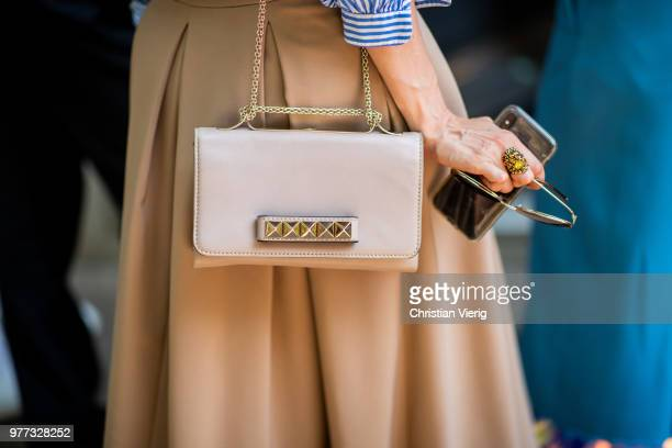 Guest wearing Valentino bag is seen outside Sunnei during Milan Men's Fashion Week Spring/Summer 2019 on June 17, 2018 in Milan, Italy.