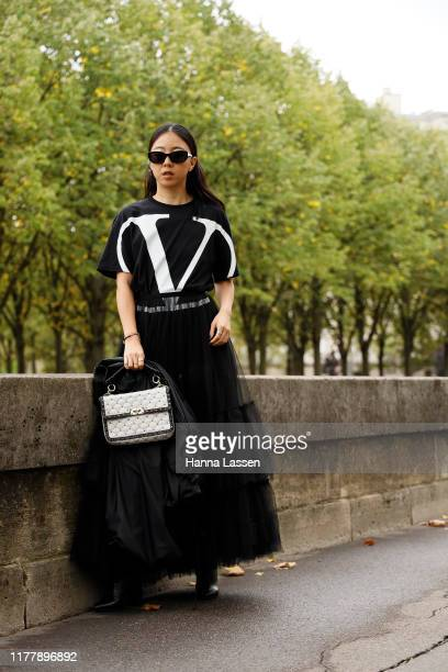 A guest wearing Valentino dress outside Valentino during Paris Fashion Week Womenswear Spring Summer 2020 on September 29 2019 in Paris France