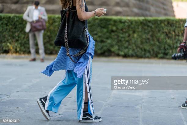 A guest wearing Vans blue jogger pants net socks is seen during Pitti Immagine Uomo 92 at Fortezza Da Basso on June 15 2017 in Florence Italy