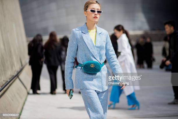 A guest wearing velvet Gucci funny bag blue suit is seen at the Hera Seoul Fashion Week 2018 F/W at Dongdaemun Design Plaza on March 20 2018 in Seoul...