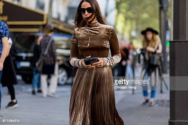 A guest wearing velvet outside Balmain on September 29 2016 in Paris France