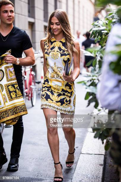A guest wearing Versace dress is seen in the streets of Milan before the Versace show during Milan Men's Fashion Week Spring/Summer 2019 on June 16...
