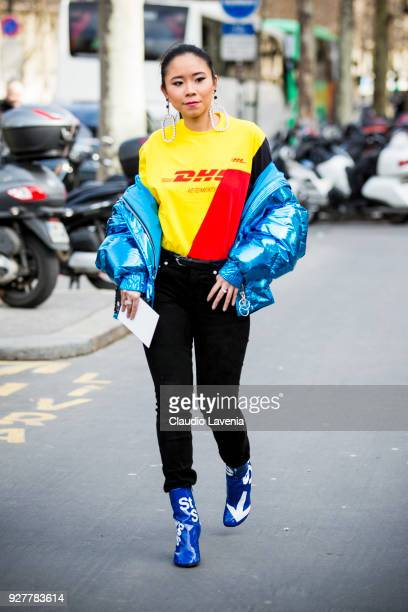 Guest, wearing Vetements tshirt and blue laminated down jacket, is seen in the streets of Paris before the Giambattista Valli show during Paris...