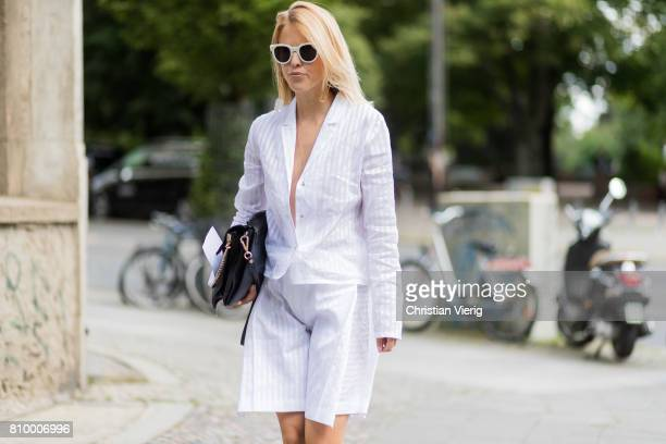 A guest wearing white blouse and shorts during the MercedesBenz Fashion Week Berlin Spring/Summer 2018 at Kaufhaus Jandorf on July 6 2017 in Berlin...