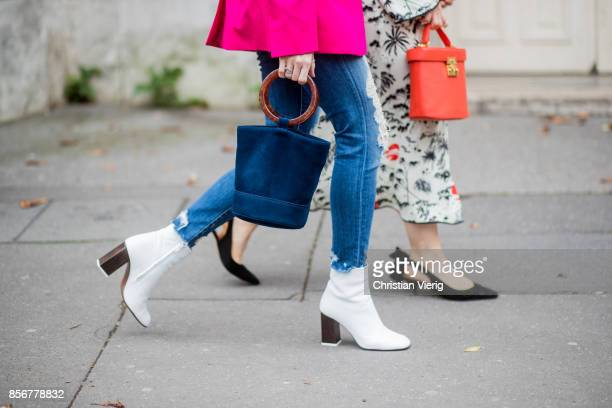 A guest wearing white boots bag seen outside Sacai during Paris Fashion Week Spring/Summer 2018 on October 2 2017 in Paris France