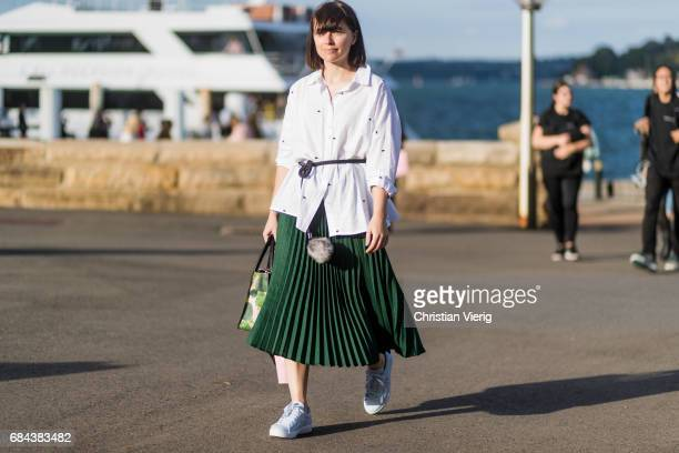 A guest wearing white button shirt green skirt outside Dyspnea at day 5 during MercedesBenz Fashion Week Resort 18 Collections at Sydney Opera House...