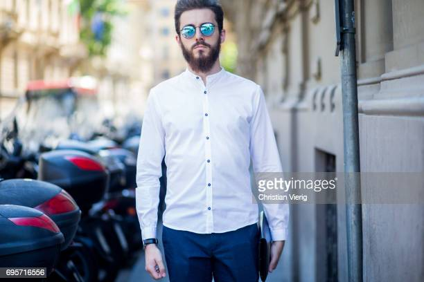 A guest wearing white button shirt is seen during Pitti Immagine Uomo 92 at Fortezza Da Basso on June 13 2017 in Florence Italy