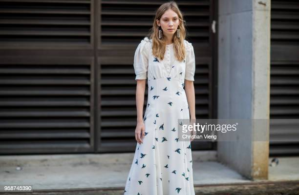 A guest wearing white dress during MercedesBenz Fashion Week Resort 19 Collections at Carriageworks on May 15 2018 in Sydney Australia