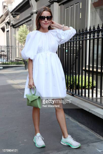 Guest wearing white dress, green snakeskin purse, sunglasses attends a OSMAN presentation at The Mandrake Hotel on September 21, 2020 in London,...