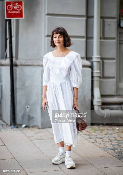 A guest wearing white dress is seen during Stockholm Runway SS19 on August 29 2018 in Stockholm Sweden