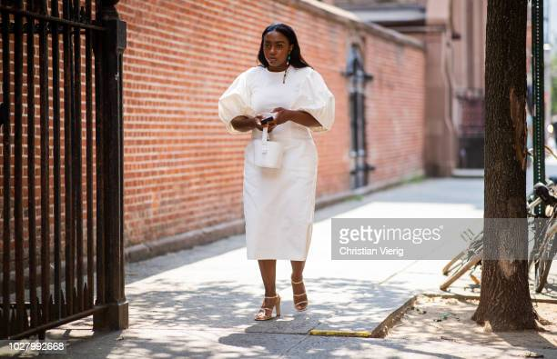 Guest wearing white dress is seen outside Collina Strada during New York Fashion Week Spring/Summer 2019 on September 6, 2018 in New York City.