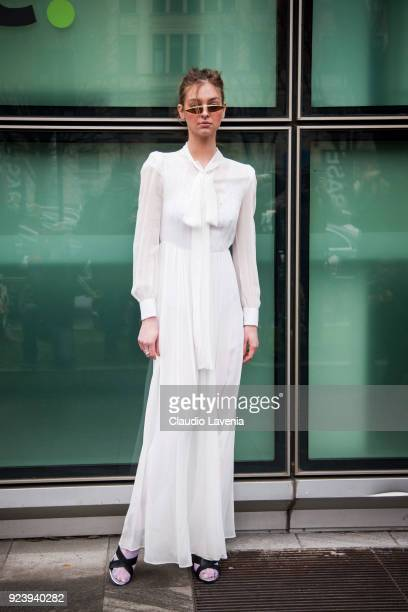 Guest wearing white dress is seen outside Giorgio Armani show during Milan Fashion Week Fall/Winter 2018/19 on February 24 2018 in Milan Italy