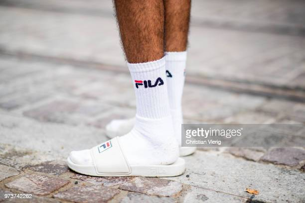 A guest wearing white Fila socks and bathing shoes is seen during the 94th Pitti Immagine Uomo on June 13 2018 in Florence Italy