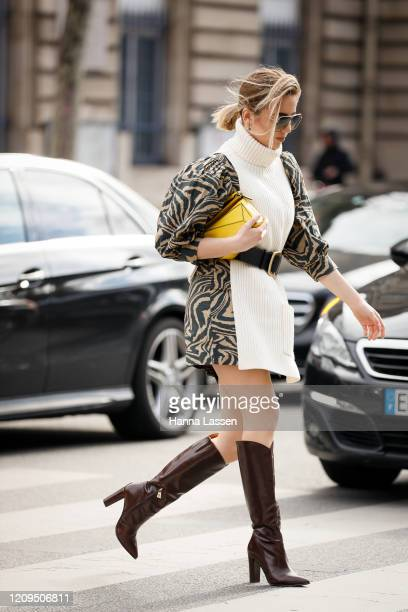 Guest wearing white high neck knit dress, brown leather boots and yellow clutch outside Vivienne Westwood show during Paris Fashion week Womenswear...