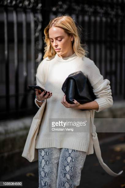 A guest wearing white knit is seen outside Erdem during London Fashion Week September 2018 on September 17 2018 in London England