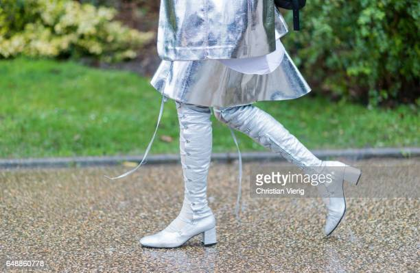 A guest wearing white laced boots outside Sacai on March 6 2017 in Paris France