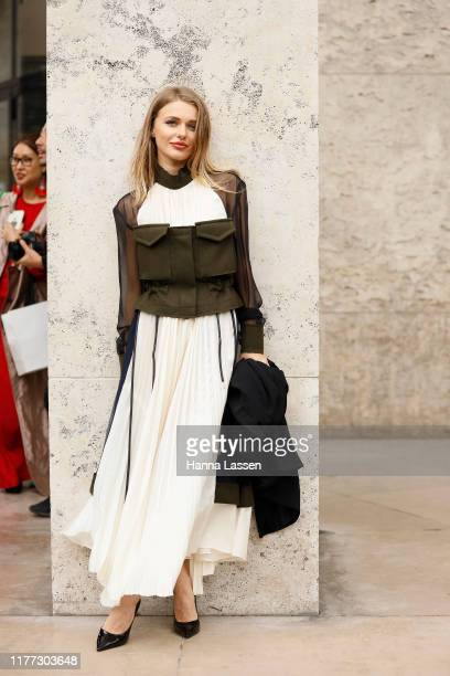 Guest wearing white pleated maxi dress and khaki corset outside Rick Owens during Paris Fashion Week - Womenswear Spring Summer 2020 on September 26,...