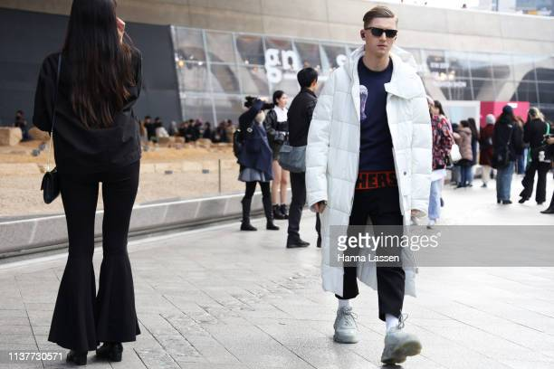 Guest wearing white puffer coat is seen at the Hera Seoul Fashion Week 2019 F/W at Dongdaemun Design Plaza at Dongdaemun Design Plaza on March 23...