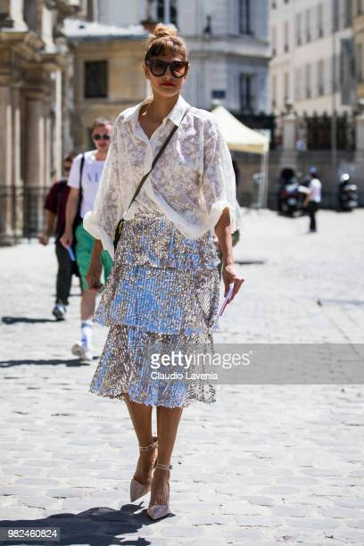 A guest wearing white shirt and silvered skirt is seen in the streets of Paris before the Thom Browne show during Paris Men's Fashion Week...