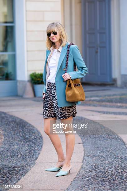 A guest wearing white shirt animalier shorts light blue jacket and suede bag is seen before the Tod's show during Milan Fashion Week Spring/Summer...