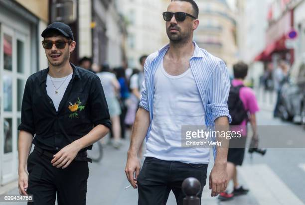 A guest wearing white undershirt blue button shirt outside Lemaire during Paris Fashion Week Menswear Spring/Summer 2018 on June 21 2017 in Paris...