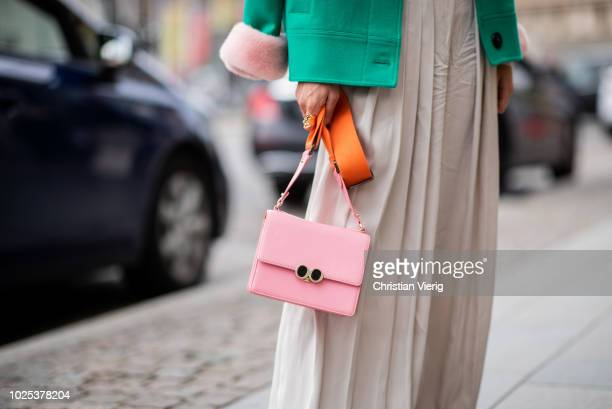 A guest wearing wide leg pants green jacket during Stockholm Runway SS19 on August 30 2018 in Stockholm Sweden