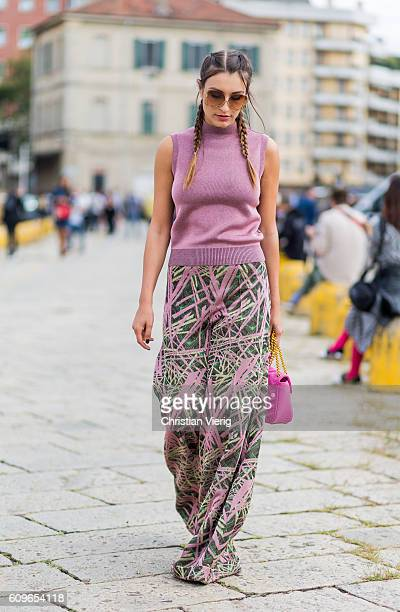 A guest wearing wide leg pants pink top and Gucci bag is seen outside Gucci during Milan Fashion Week Spring/Summer 2017 on September 21 2016 in...
