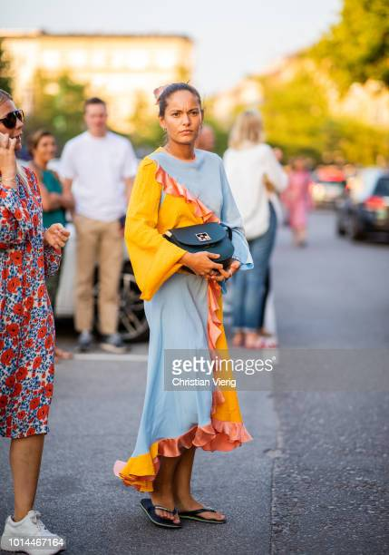 A guest wearing yellow baby blue dress is seen outside Saks Potts during the Copenhagen Fashion Week Spring/Summer 2019 on August 9 2018 in...