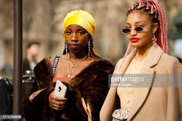 Guest wearing yellow bandana, brown faux fur coat outside the Miu Miu show during Paris Fashion Week Womenswear Fall/Winter 2020/2021 Day Nine on...