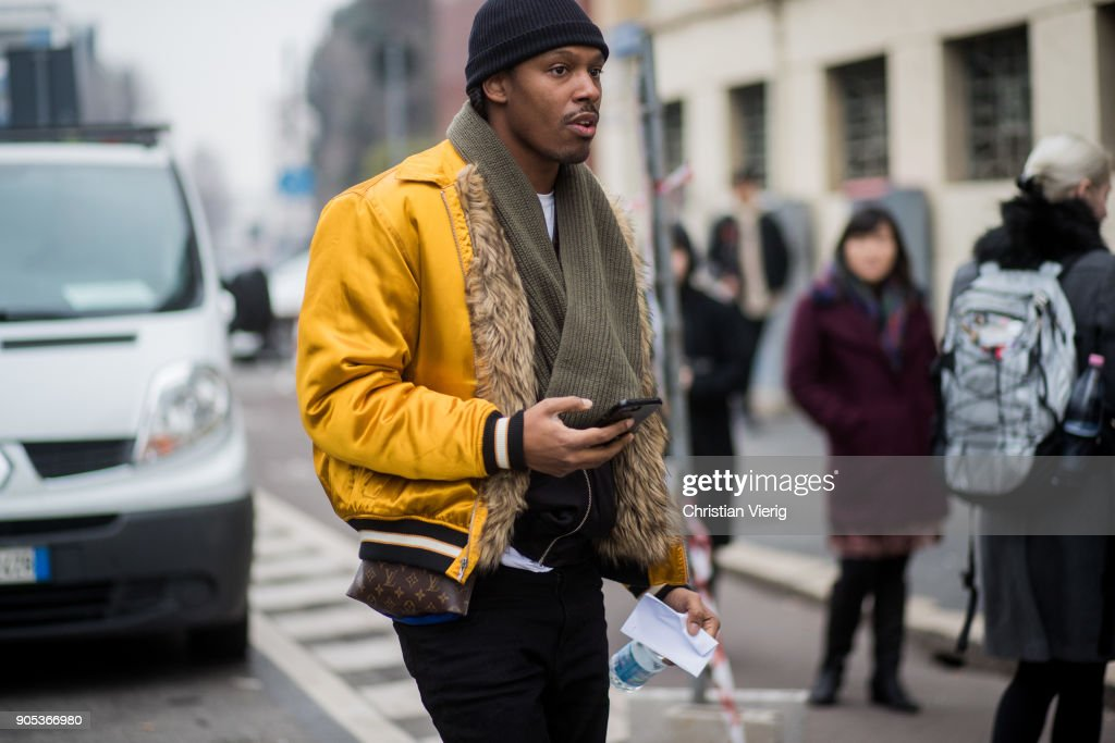 A guest wearing yellow bomber jacket seen outside Represent during Milan Men's Fashion Week Fall/Winter 2018/19 on January 15, 2018 in Milan, Italy.