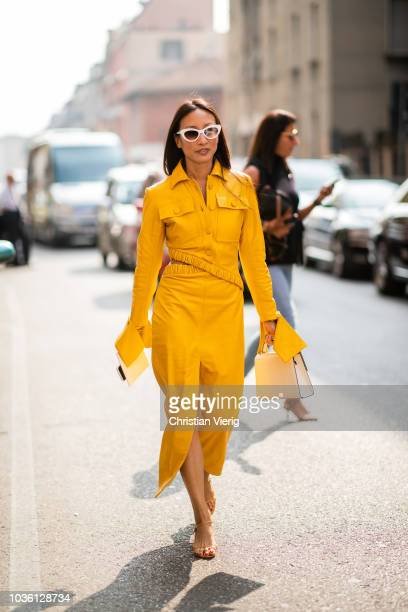 A guest wearing yellow dress with long sleeves is seen outside Jil Sander during Milan Fashion Week Spring/Summer 2019 on September 19 2018 in Milan...