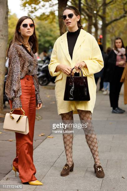 Guest wearing yellow jacket, Gucci tight and Hermes shoes outside the Altuzarra show during Womenswear Spring/Summer 2020 show Paris Fashion Week on...