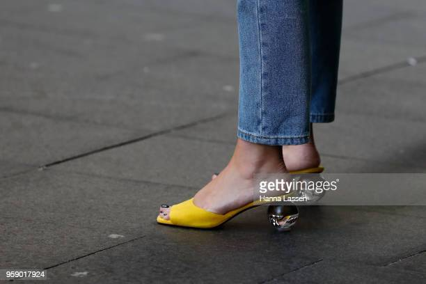 A guest wearing yellow mules during MercedesBenz Fashion Week Resort 19 Collections at Carriageworks on May 16 2018 in Sydney Australia